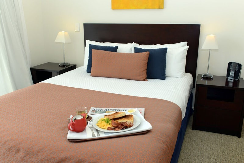 View of Hotel Bedroom with Bed in Breakfast Serviced