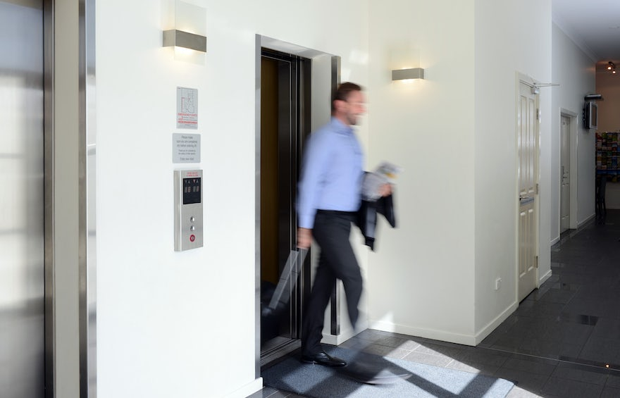 business traveler exiting the lift of macquarie waters boutique hotel