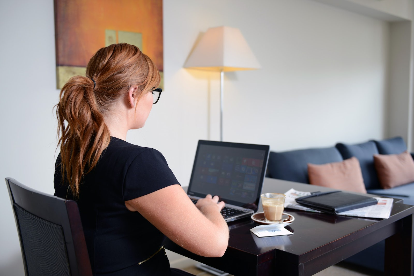 Corporate traveller working in room at macquarie waters hotel