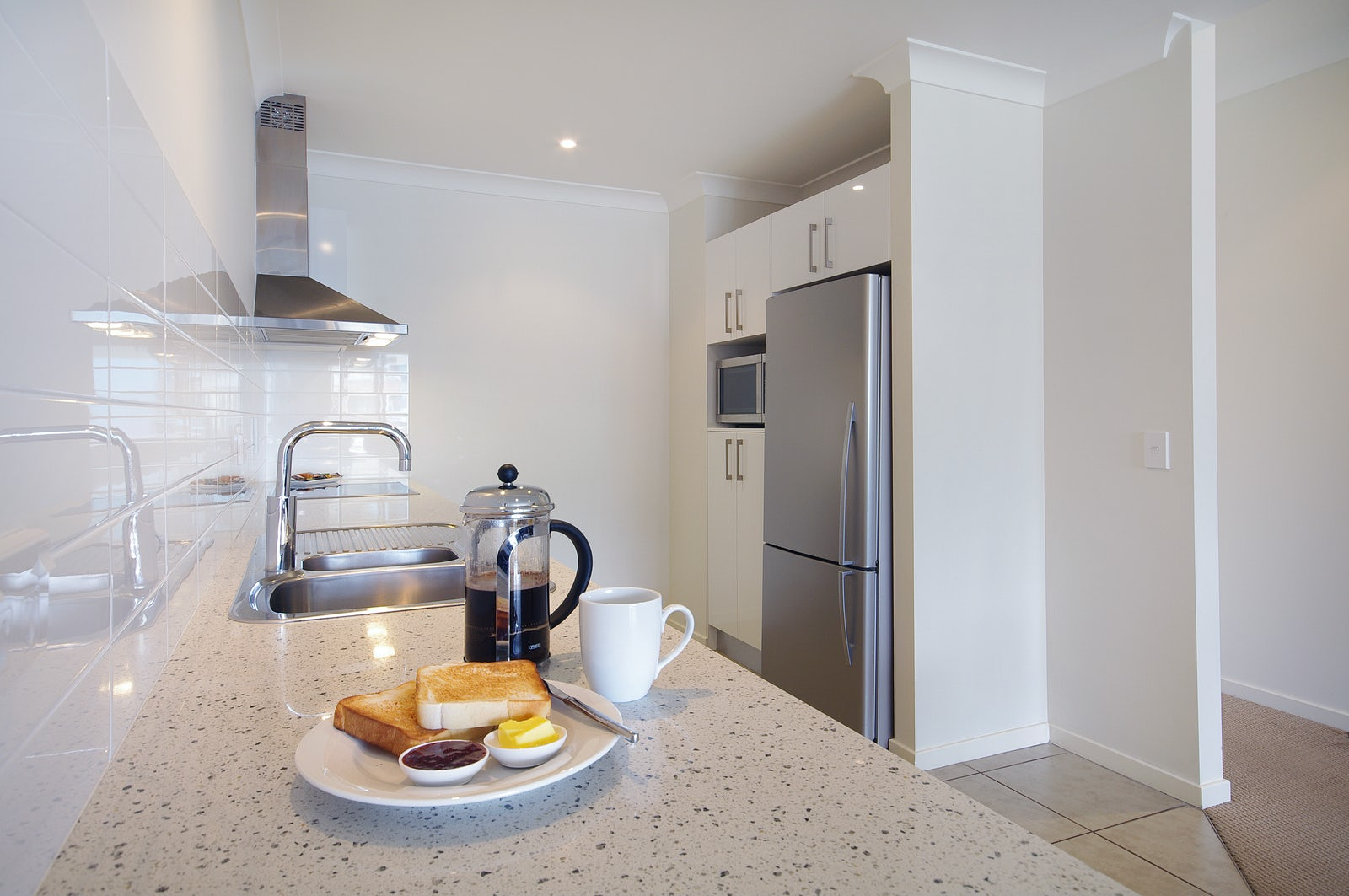Port Douglas Apartments with a full kitchen including coffee making facilities