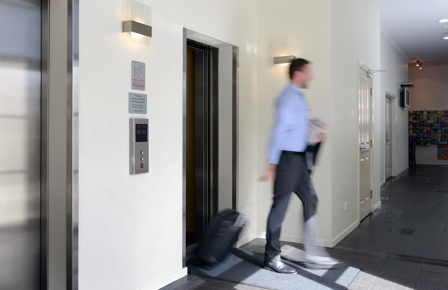 Port Macquarie Corporate Traveller Entering Hotel Lift