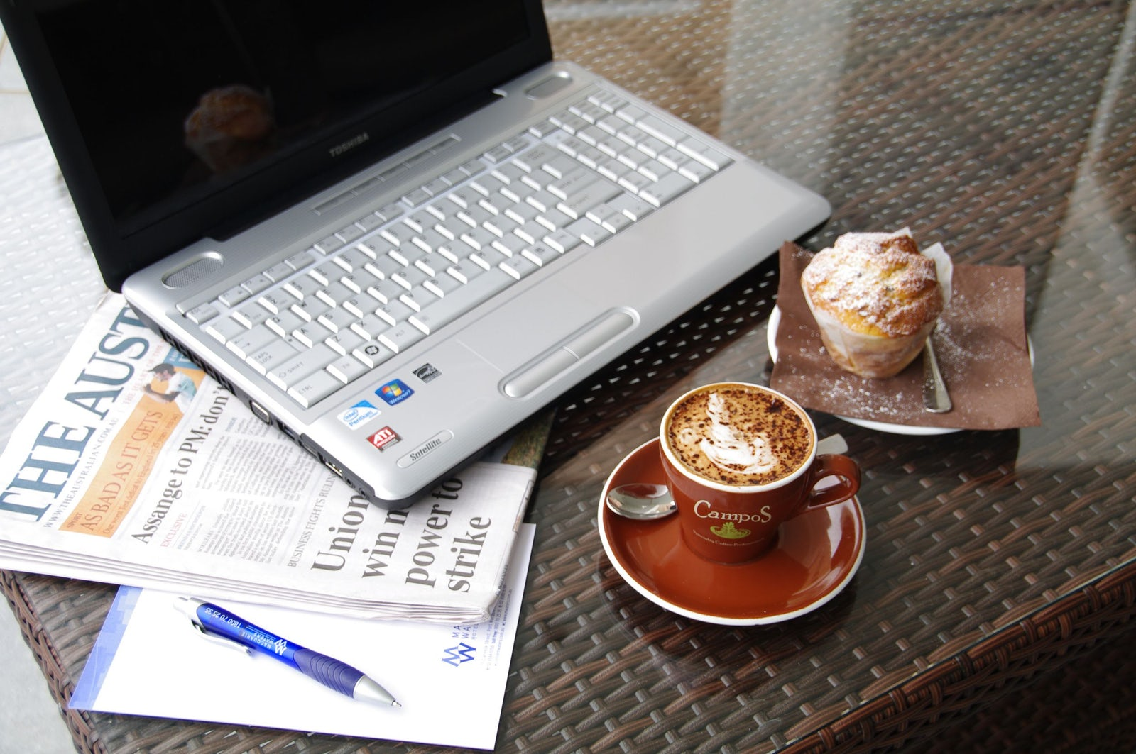 Customer Breakfast with Muffin, Coffee and Laptop